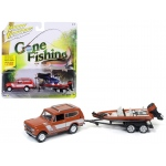 "1979 International Scout Persimmon with Bass Boat ""Gone Fishing"" 1/64 Diecast Model Car by Johnny Lightning"